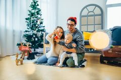 Family and little son playing home on Christmas holidays. New Year holidays Royalty Free Stock Photos