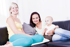 Family in living room with baby boy. Stock Photos