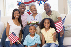 Family in living room on fourth of July. With flags and cookies smiling stock images