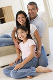 Family in living room smiling Stock Image
