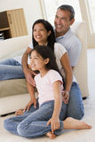 Family in living room smiling royalty free stock photos