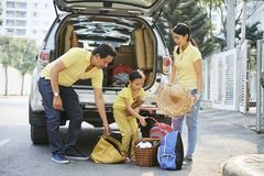 Family loading car trunk stock photography
