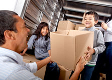 Family loading a truck Royalty Free Stock Photography