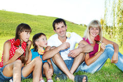 Family with lollipops Stock Photography