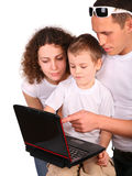 Family look on notebook royalty free stock photo