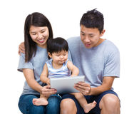 Family look at tablet together Stock Images
