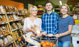 Family looking at assortment of bread rolls and bagels Royalty Free Stock Photo