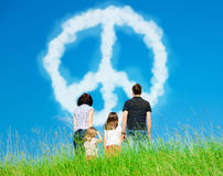 Free Family Looking At Clouds Forming A Peace Symbol Royalty Free Stock Images - 95646899