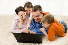 Family Looking At Laptop Stock Image