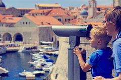 Family looking through binoculars at the city Royalty Free Stock Image