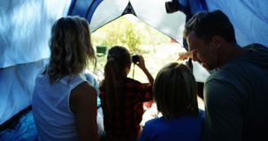 Family looking through binoculars while sitting in the tent 4k. Rear view of family looking through binoculars while sitting in the tent 4k stock video
