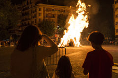 Family looking at a bonfire, Barcelona Stock Images