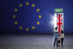 Family looking at brexit door Stock Image