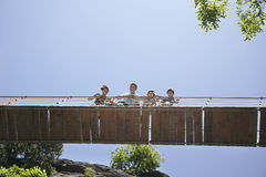 Family Looking Down From Bridge Against Clear Sky Stock Image