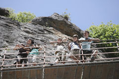 Family Looking Down From Bridge Against Rocks Royalty Free Stock Photography