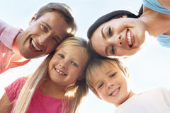 Family Looking Down Into Camera Royalty Free Stock Photo