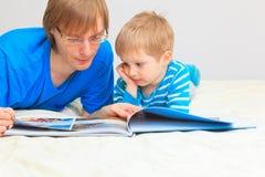 Family looking at family photo album Stock Photos
