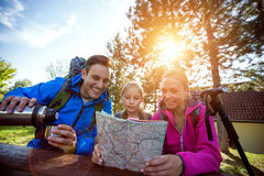 Family looking at hiking map. Forest royalty free stock images