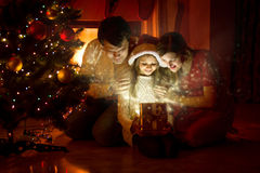 Family looking inside of magic Christmas gift box Royalty Free Stock Photography