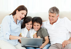 Family looking at  the laptop Stock Photos