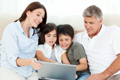 Family looking at  the laptop Royalty Free Stock Photography