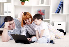 Family looking at a laptop Stock Photo