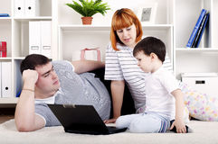 Family looking at a laptop Stock Image