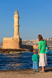 Family looking at lighthouse in Crete Stock Photo