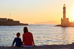 Family looking at lighthouse in Crete Stock Images