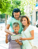 Family looking at the map at city Stock Photos