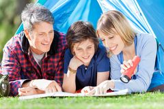 Family Looking At Map In Tent Royalty Free Stock Photos