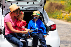 Family looking at map while travel by car Royalty Free Stock Photography