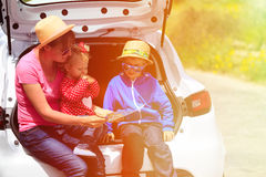 Family looking at map while travel by car Stock Photo