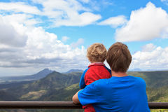 Family looking at mountains of Mauritius. Family looking at Mauritius mountains in Black river georges Stock Photo