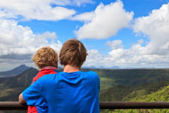 Family looking at mountains of Mauritius. Family looking at Mauritius mountains in Black river georges Royalty Free Stock Photography