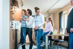 Family looking at a new kitchen in the showroom. Happy family looking at a new kitchen in the showroom stock photo