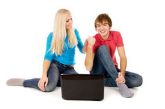 Family is looking into the notebook computer and rejoices Royalty Free Stock Images