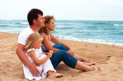 Family looking at the ocean Royalty Free Stock Image