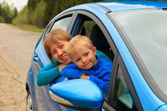 Family  looking out from car window Stock Photography