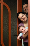 Family is looking out of the door Royalty Free Stock Photos