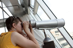 Family looking through pay binoculars Royalty Free Stock Image