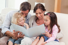 Family looking at a photo album Stock Photos
