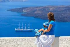 Family looking at Santorini, Greece Royalty Free Stock Photography