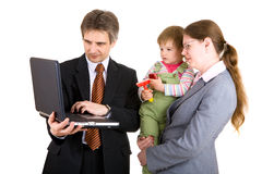 Family looking into the screen of laptop Stock Photo