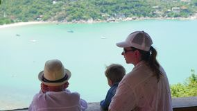 Family looking at the sea and the mountains from a height. Panoramic view stock video