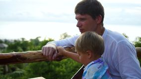 Family looking at the sea and the mountains from a height. Panoramic view stock footage