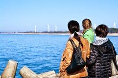 Family looking at sea stock image