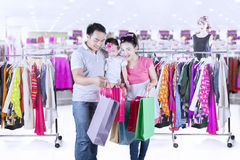 Family looking shopping bags at mall Stock Photos