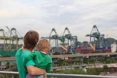 Family looking at Singapore port Stock Images