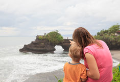 Family looking at temple in Bali Stock Image